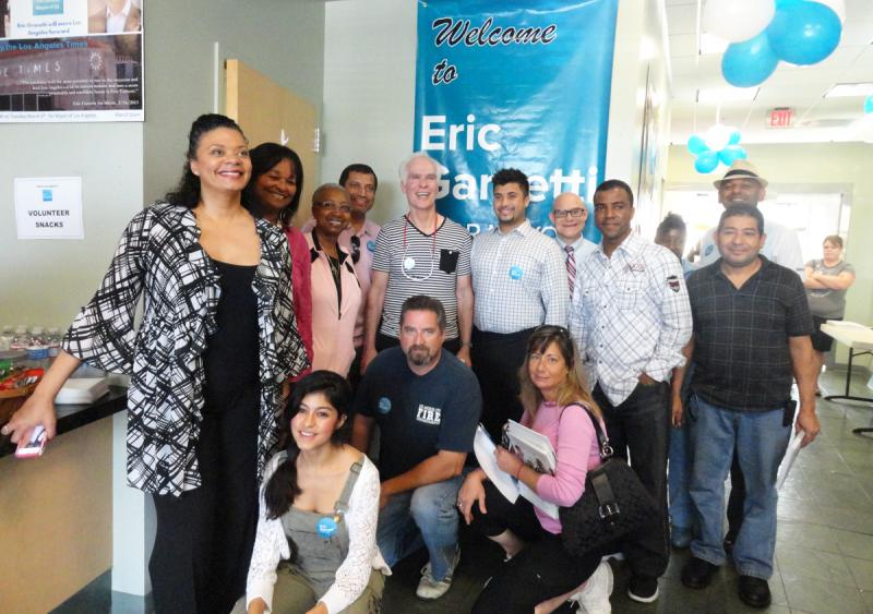 Gil Garcetti poses with volunteers for Eric Garcetti's Facebook page photo. (Gracie Zheng/Neon Tommy)
