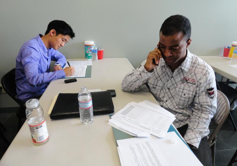 Timothy Kim (left) and Jason Seward (right) call up L.A. voters to support Eric Garcetti. (Gracie Zheng/Neon Tommy)