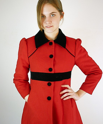 A red coat like this will keep you warm and stylish. (flickr.com)