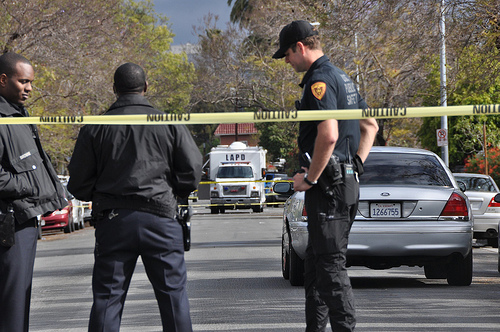 Police stand guard at the crime scene April 11. (Alan Mittelstaedt/Neon Tommy)
