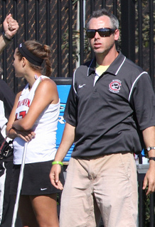 Brian Eisenberg looks on in his first season as an NCAA coach and fifth with the team. (Larry Newman/Chapman Athletics)