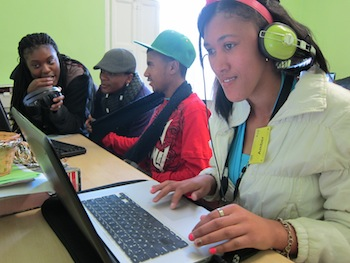 A young reporter editing in Paarl, South Africa. (Tricia Tongco/Neon Tommy)