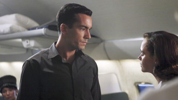 "Maggie (Christina Ricci) having an intense stare-off with cowardly passenger Miguel (Aaron Diaz). P.S. she won. ""Pan Am"" ABC Sundays at 10. (Photo courtesy of ABC)"