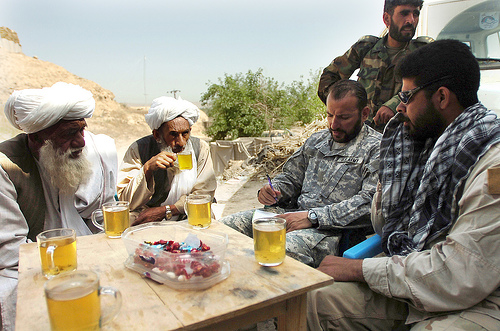 Special Forces company commander met with village elders and members of the Afghan National Army Corps in 2007 to discuss military operations in the Sangin District. It is the same area where three U.S. soldiers were killed Friday. (U.S. Army/Flickr)