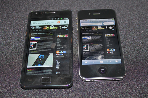 The older Samsung Galaxy SII next to Apple's iPhone 4. (gillyberlin/flickr).