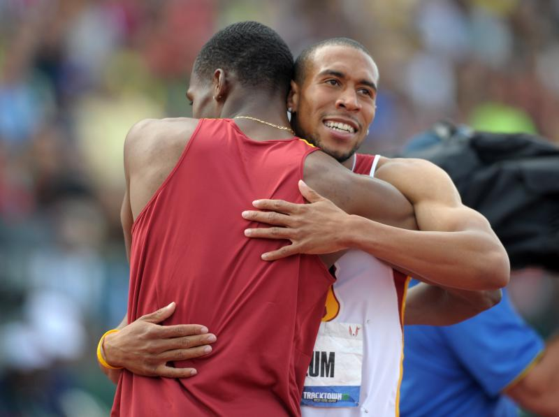 Josh Mance (left) and Bryshon Nellum (right) hug after Nellum won a spot to compete in London. (USC Trojans/Kirby Lee)