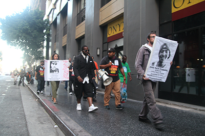 Protesters march along the streets of downtown Los Angeles to protest police brutality on Oct. 22, 2015. (Whitney Ashton/Annenberg Media)