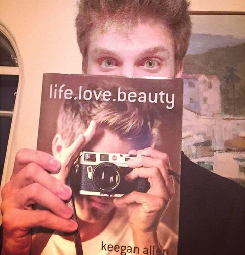 Keegan Allen and his gorgeous eyes model his new photobook, life.love.beauty (Instagram/@keeoone).