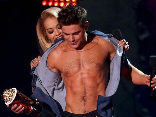 Will Zac Efron win Best Shirtless Performance for the second year in a row at the MTV Video Movie Awards? (Twitter/@dollymag)