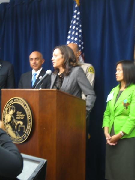 State Attorney General Kamala Harris.  On right, trafficking victim and activist Ima Mitul.
