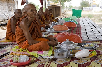 Cambodian monks feasting (Creative Commons/Flickr)